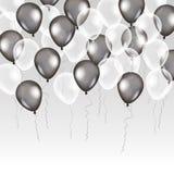 在背景的黑白色透明气球 免版税库存图片