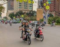 在胡志明街道上的摩托车  免版税库存照片