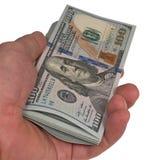 在胳膊的美元 免版税库存图片