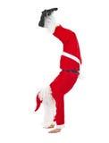 在脚的圣诞老人常设头 库存图片