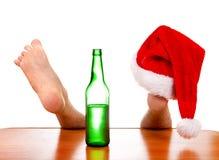 在腿的圣诞老人帽子 库存照片