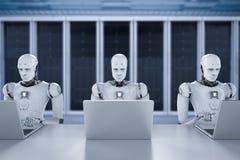 在膝上型计算机的机器人工作 免版税库存图片