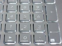 在膝上型计算机银色键盘的数字钥匙  免版税库存图片