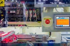 在自动机器的紧急刹车按钮 免版税库存照片