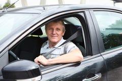 在自己的汽车的驱动器 免版税库存照片