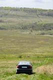 在自然背景2的汽车 免版税库存图片