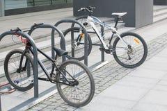 在自行车停车处的两辆自行车 图库摄影
