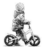 在自行车的孩子 库存照片