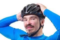在自行车盔甲的成人 免版税库存照片
