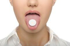 在舌头妇女的大片剂 库存图片