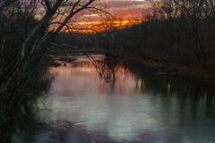 在舔的河的日出 图库摄影