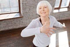 在舞厅的迷人的年长妇女跳舞 免版税库存照片