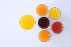 在色的背景的汁液 图库摄影