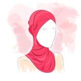 在色的hijab打扮的妇女 免版税库存照片