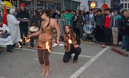 在节日跟特春天的火dansers 图库摄影