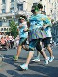 在芭蕾舞短裙的肥头大耳的赛跑者 库存图片