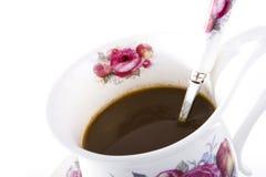在花卉杯子的咖啡 图库摄影