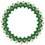 在花圈形状的圆的框架用霍莉莓果 免版税图库摄影