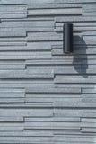 在花岗岩墙壁上的光 免版税库存图片