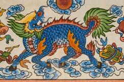 在花岗岩墙壁上的蓝色kirin绘画 免版税库存照片