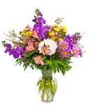 在花瓶的五颜六色的花花束排列 库存照片