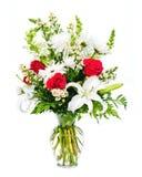 在花瓶的五颜六色的花花束排列 库存图片