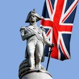 在英国国旗的纳尔逊雕象 库存图片