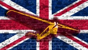 在英国旗子背景的减速火箭的飞机飞行 免版税图库摄影