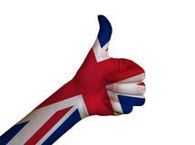 在英国的旗子报道的手 免版税库存照片