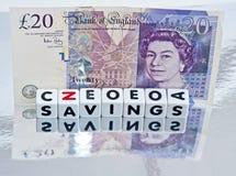 在英镑举行的储款 免版税库存图片