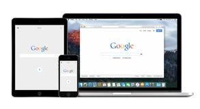 在苹果计算机iPhone iPad和苹果计算机Macbook赞成视网膜的谷歌app 库存图片