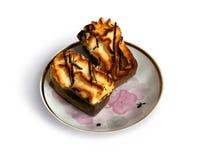 在茶碟的蛋糕 免版税库存照片