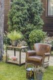 在草坪的扶手椅子 免版税库存照片