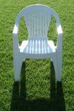 在草的椅子 库存照片