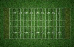 在草的橄榄球领域 免版税库存图片