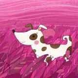 在草的逗人喜爱的动画片狗 免版税图库摄影