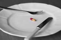 在药片的膳食 库存图片