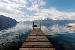 在莱芒湖停泊的小划艇在瑞士 免版税库存照片