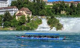 在莱茵瀑布的小船在瑞士 免版税库存图片