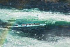 在莱茵瀑布的游览小船在瑞士 免版税库存图片