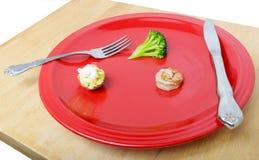 在菜盘的少量的食物 免版税库存图片