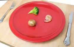 在菜盘的少量的食物 免版税库存照片