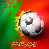 在葡萄牙旗子背景的足球 图库摄影