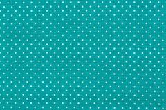 在葡萄酒光点图形的蓝色棉织物 免版税库存照片