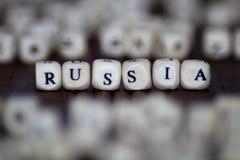 在葡萄酒写的词`俄罗斯`,木立方体 免版税图库摄影