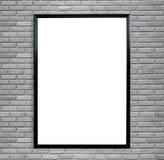 在葡萄酒砖墙上的空白的海报照片框架 免版税库存照片
