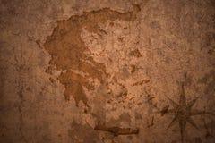 在葡萄酒纸背景的希腊地图 免版税库存图片
