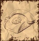 在葡萄酒背景的减速火箭的电话 库存照片