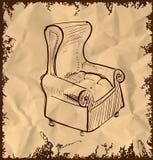 在葡萄酒背景的皮革扶手椅子 免版税库存图片