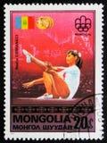 在蒙古打印的岗位邮票显示纳迪娅・科马内奇,大约1976年 免版税库存图片